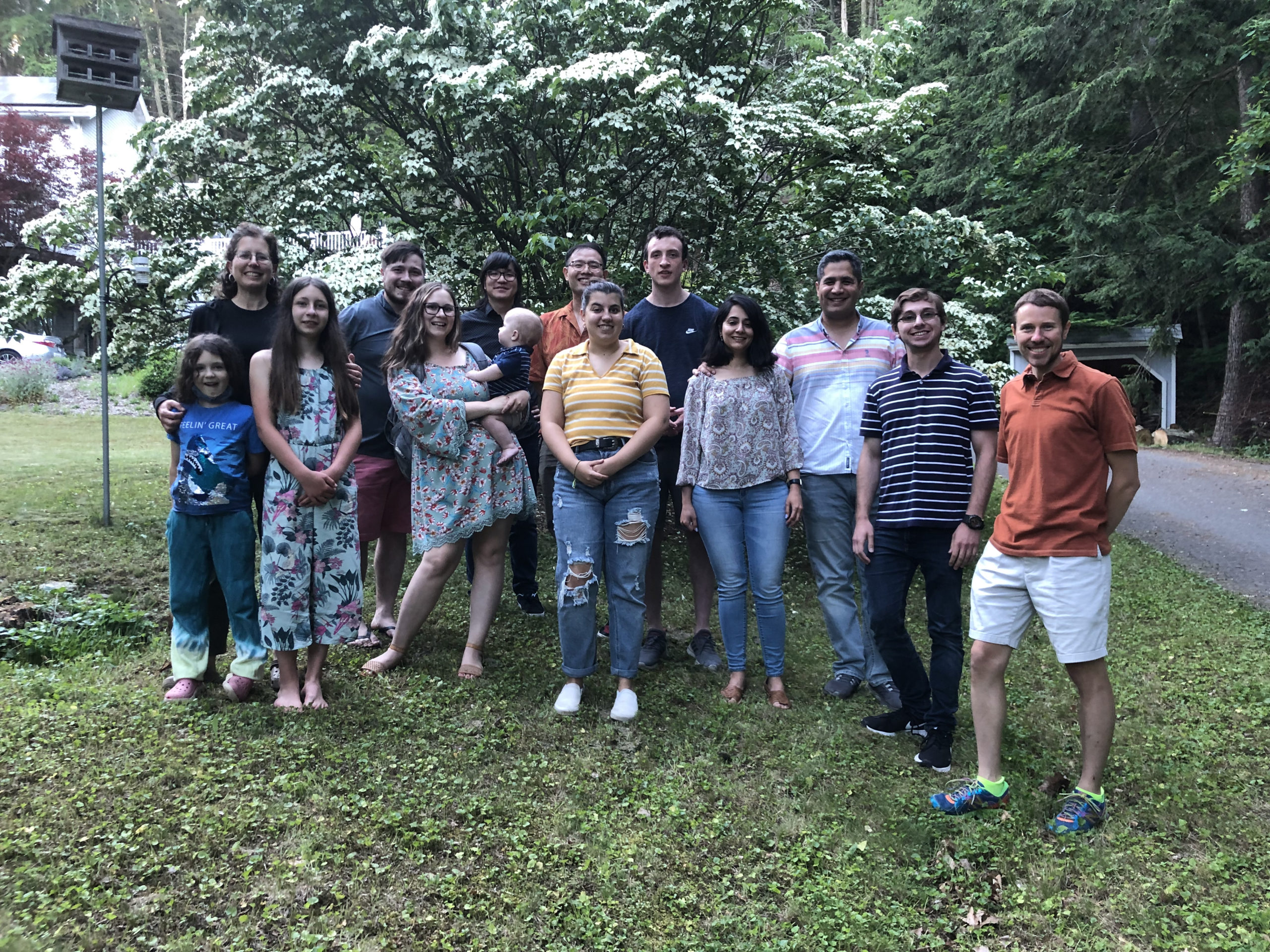 Lab group in front of flowering dogwood